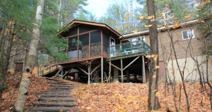 View of the front of the cottage looking up from the lake